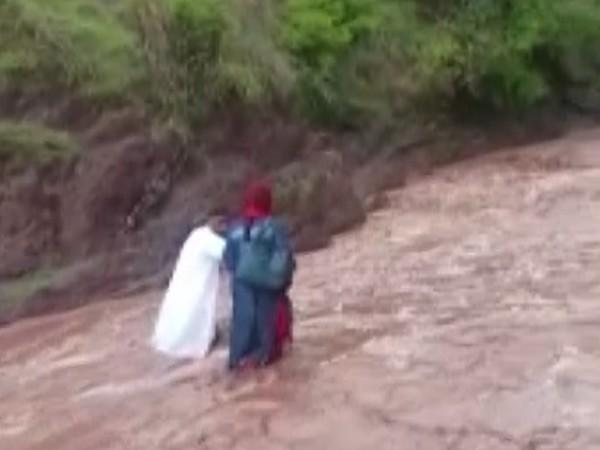 The team of health workers crossing the river.