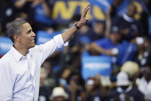 President Barack Obama waves during a campaign event at Scott High School on September 3, 2012 in Toledo, Ohio. Obama delivered remarks during a UAW Labor Day Celebration before heading to Louisiana to view damage from flooding in the wake of Hurricane Isaac. (Photo by J.D. Pooley/Getty Images)