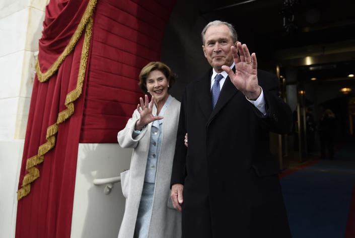 <p>Former President George W. Bush and his wife Laura Bush wave as they arrive on Capitol Hill in Washington, Friday, Jan. 20, 2017, for the presidential inauguration of Donald Trump. (Photo: Saul Loeb via AP, Pool) </p>