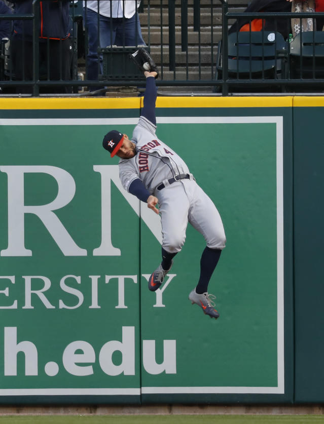 Houston Astros right fielder George Springer catches a Detroit Tigers' Niko Goodrum fly ball in the first inning of a baseball game in Detroit, Monday, May 13, 2019. (AP Photo/Paul Sancya)
