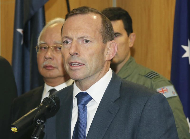 FILE - In this Thursday, April 3, 2014 file photo, Australian Prime Minister Tony Abbott speaks as Malaysia Prime Minister Najib Razak, left, looks on during a breakfast with crew members from different countries involved in the search for wreckage and debris of the missing Malaysia Airlines Flight 370 in Perth, Australia. Abbott said in Shanghai, China, Friday, April 11, that authorities are confident that a series of underwater signals detected in a remote patch of the Indian Ocean are coming from the missing Malaysia Airlines plane. (AP Photo/Rob Griffith, Pool, File)
