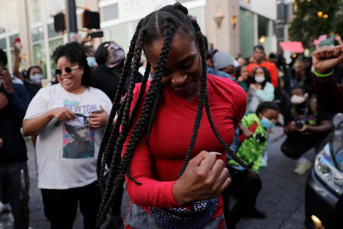 Demonstrators march, Sunday, May 31, 2020, in Atlanta. Protests continued following the death of George Floyd, who died after being restrained by Minneapolis police officers on May 25. (AP Photo/Brynn Anderson)
