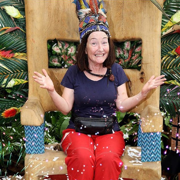 A photo of comedian Fiona O'Loughlin wearing a tribal crown and sitting on a throne after winning the fourth season of the Australian version of I'm a Celebrity...Get Me Out of Here!