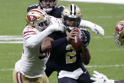 New Orleans Saints quarterback Jameis Winston (2) is sacked by San Francisco 49ers defensive end Kerry Hyder in the second half of an NFL football game in New Orleans, Sunday, Nov. 15, 2020. (AP Photo/Butch Dill)