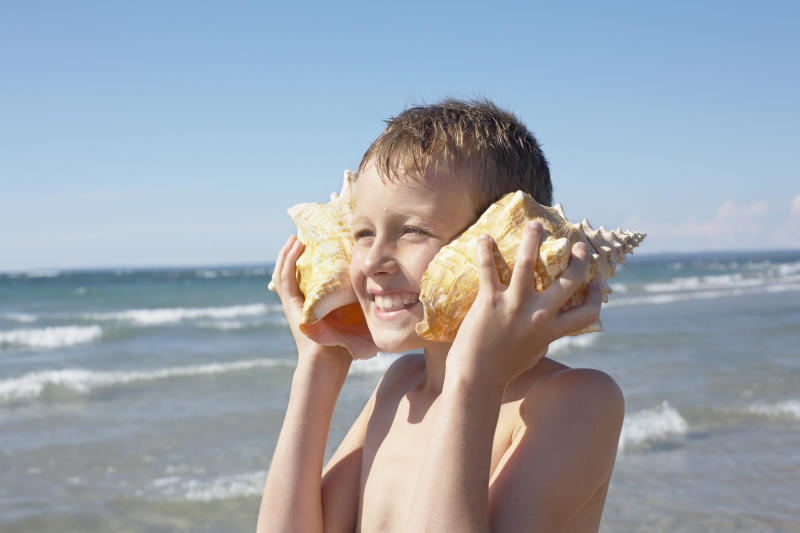 "Odds are someone told you as a child, ""If you hold a seashell up to your ear, you'll hear the ocean.""  (Radius Images via Getty Images)"