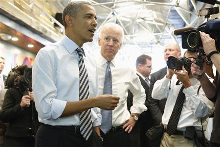 Obama and Biden talk to reporters before ordering at a sandwich shop near the White House in Washington