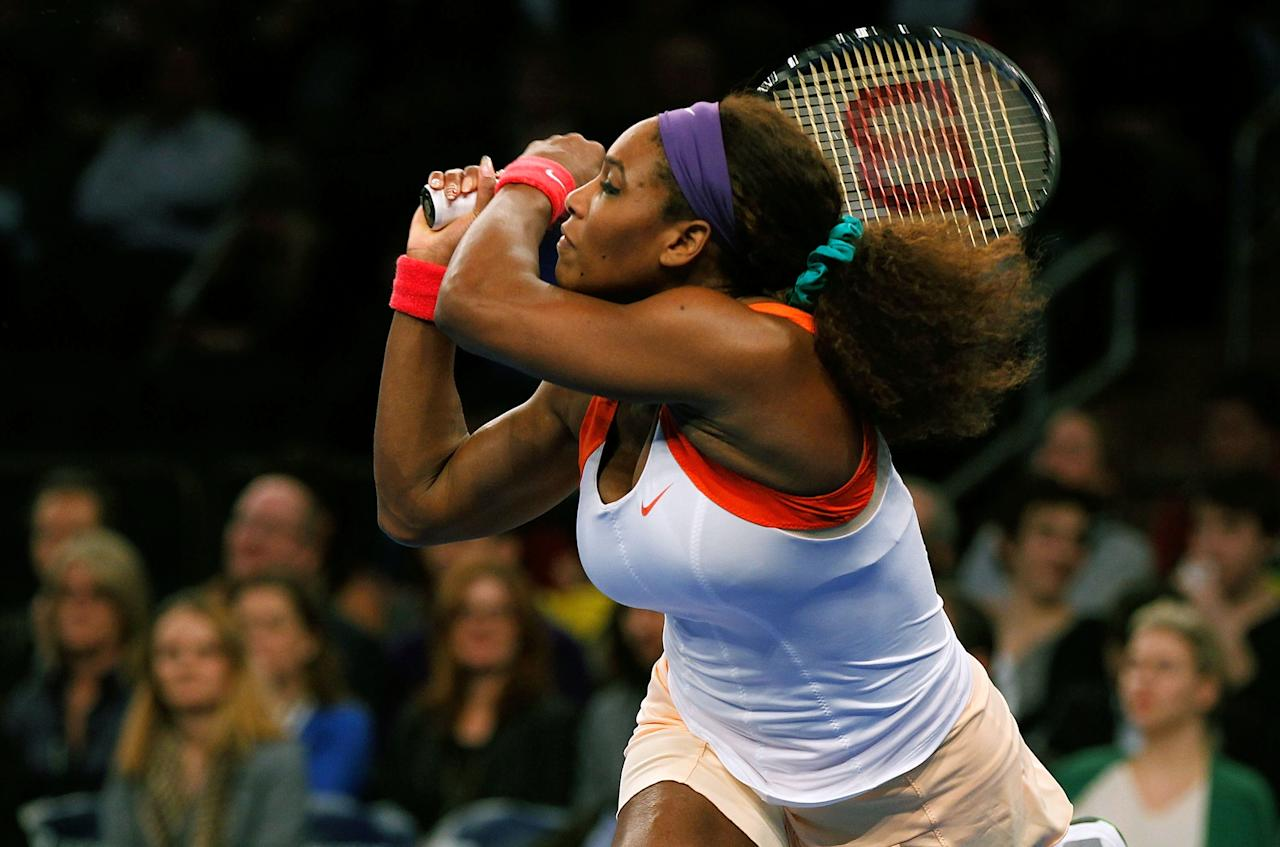 NEW YORK, NY - MARCH 04:  Serena Williams of the USA returns a shot to Victoria Azarenka of Belarus during the BNP Paribas Showdown at Madison Square Garden on March 4, 2013 in New York City.  (Photo by Mike Stobe/Getty Images for StarGames)