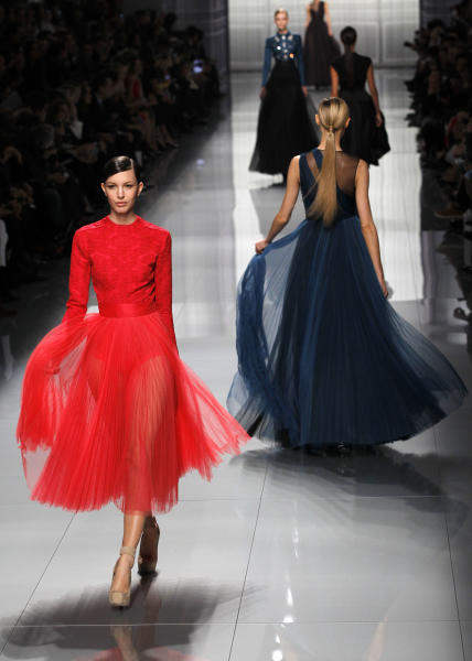 Models wear creations from designer Christian Dior as part of the Fall-Winter, ready-to-wear 2013 fashion collection, during Paris Fashion week, Friday, March 2, 2012. (AP Photo/Christophe Ena)