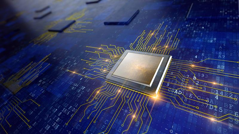 Semiconductor chip on blue background.