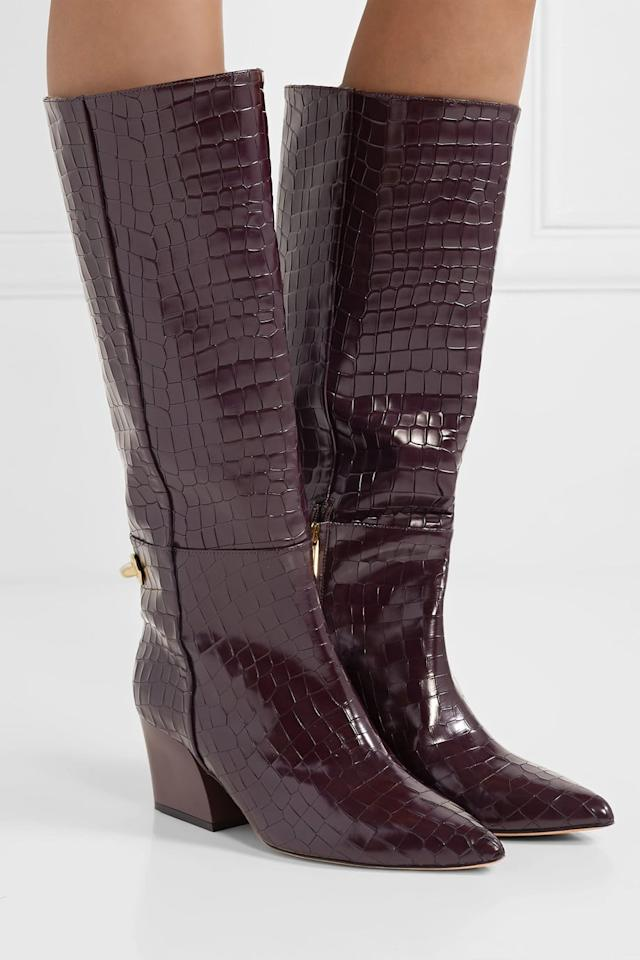 """<p><a href=""""https://www.popsugar.com/buy/Tibi-Rowan-Glossed-Croc-Effect-Leather-Knee-Boots-489013?p_name=Tibi%20Rowan%20Glossed%20Croc%20Effect%20Leather%20Knee%20Boots&retailer=net-a-porter.com&pid=489013&price=1%2C150&evar1=fab%3Aus&evar9=46565054&evar98=https%3A%2F%2Fwww.popsugar.com%2Ffashion%2Fphoto-gallery%2F46565054%2Fimage%2F46595843%2FTibi-Rowan-Glossed-Croc-Effect-Leather-Knee-Boots&list1=fall%20fashion%2Cshoes%2Cboots%2Ctrends%2Cfall&prop13=mobile&pdata=1"""" rel=""""nofollow"""" data-shoppable-link=""""1"""" target=""""_blank"""" class=""""ga-track"""" data-ga-category=""""Related"""" data-ga-label=""""https://www.net-a-porter.com/us/en/product/1172622/tibi/rowan-glossed-croc-effect-leather-knee-boots"""" data-ga-action=""""In-Line Links"""">Tibi Rowan Glossed Croc Effect Leather Knee Boots</a> ($1,150)</p>"""
