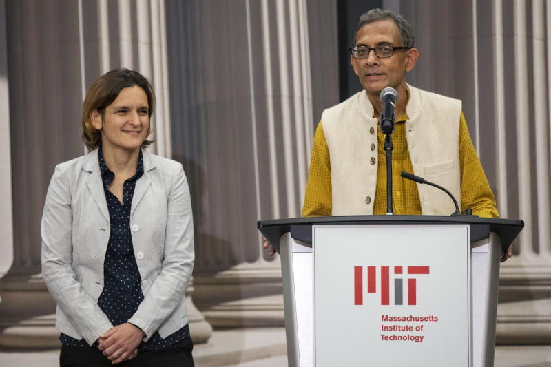 Abhijit Banerjee, right, talks during a news conference with Esther Duflo at Massachusetts Institute of Technology in Cambridge, Mass., Monday, Oct. 14, 2019. Banerjee and Duflo, along with Harvard's Michael Kremer, were awarded the 2019 Nobel Prize in economics for pioneering new ways to alleviate global poverty. (AP Photo/Michael Dwyer)