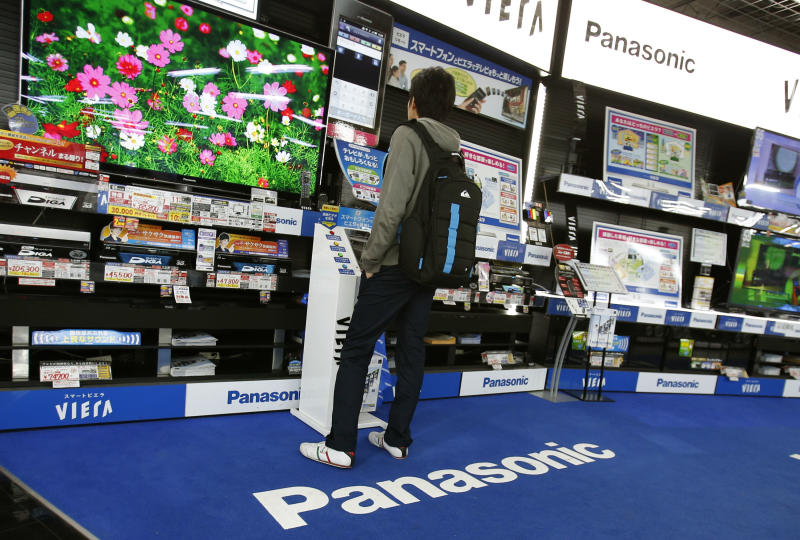 A shopper looks at a Panasonic flat-panel television at an electronics retail store in Tokyo Thursday, March 28, 2013. Panasonic Corp.'s president said Thursday the company will get out of unprofitable businesses but stopped short of ditching the Japanese manufacturer's money-losing TV operations, as had been widely speculated. (AP Photo/Shizuo Kambayashi)