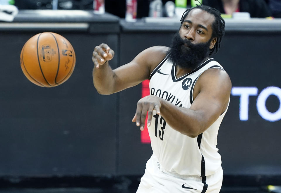 James Harden with the ball in front of his after he fires off a pass.