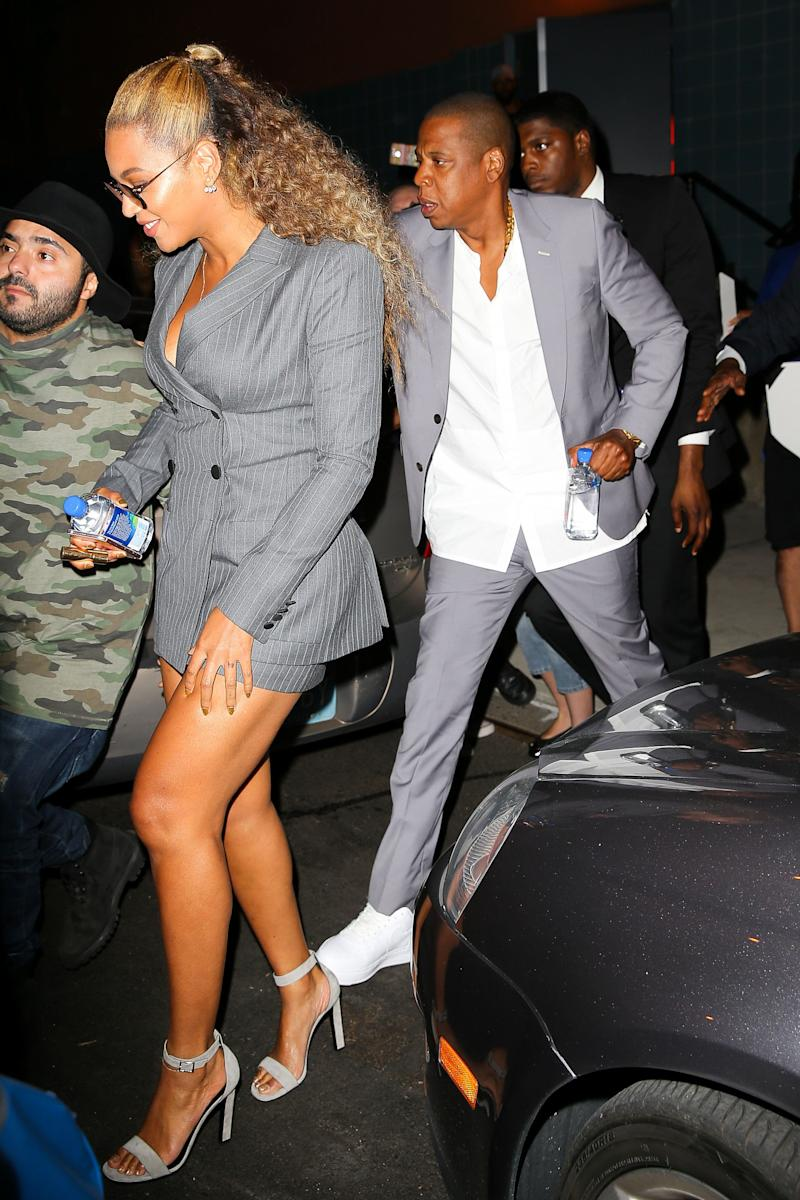 Beyonce is all smiling while leaving the Hands Of Stone Premier with husband Jay Z in New York City, the couple where trying to run away from paparazzi and fans, Beyonce and Jay Z where matching suits, Jay Z was trying hard to stop a fan who want to get a selfie with Beyonce <P> Pictured: Beyonce and Jay Z <B>Ref: SPL1338834 220816 </B><BR/> Picture by: Felipe Ramales / Splash News<BR/> </P><P> <B>Splash News and Pictures</B><BR/> Los Angeles: 310-821-2666<BR/> New York: 212-619-2666<BR/> London: 870-934-2666<BR/> photodesk@splashnews.com<BR/> </P>