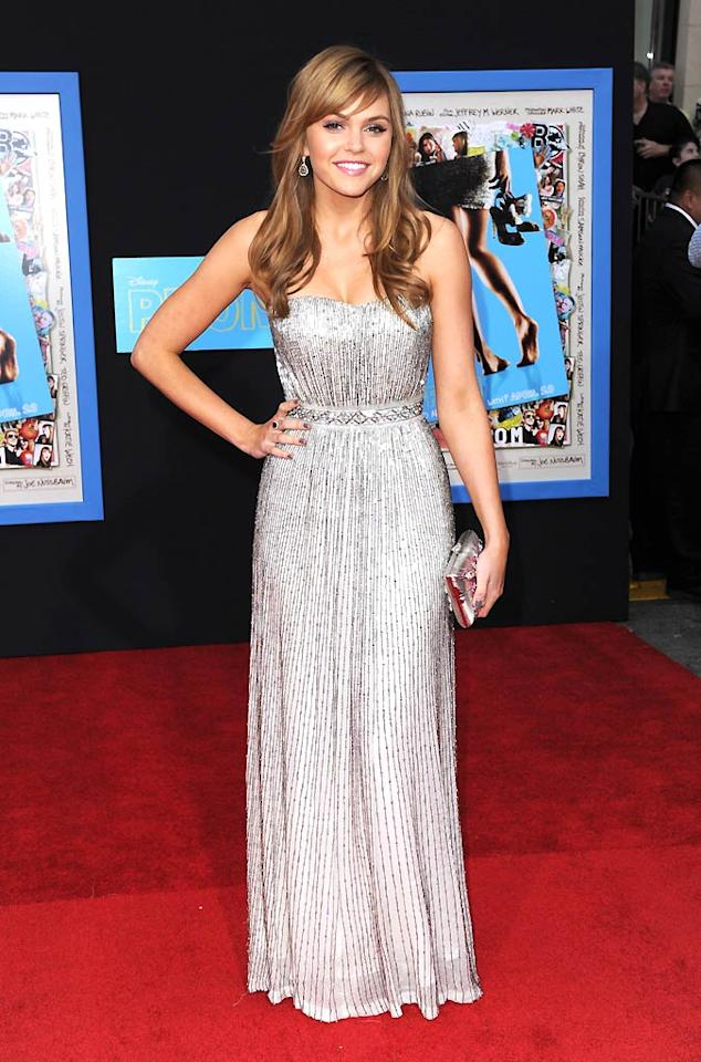 "On the other side of L.A., ""Friday Night Lights"" star Aimee Teegarden popped a pose at the world premiere of her new comedy, ""Prom,"" in a sparkling Pamella Roland gown. A matching silver clutch, sophisticated baubles, and side-swept bangs completed her flawless look. Craig Barritt/<a href=""http://www.wireimage.com"" target=""new"">WireImage.com</a> - April 21, 2011"