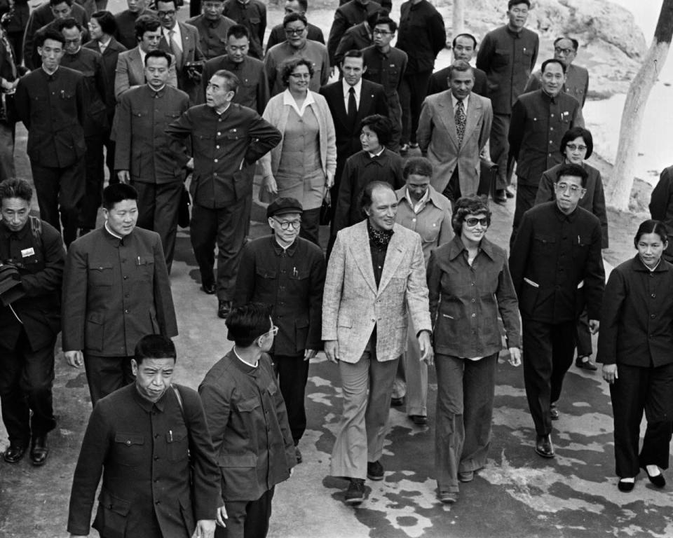 Former prime minister Pierre Trudeau and wife Margaret walk ahead of frormer Chinese premier Zhou Enlai during a visit to the grottoes in Luoyang, China, on Oct. 14, 1973. THE CANADIAN PRESS/PETER BREGG
