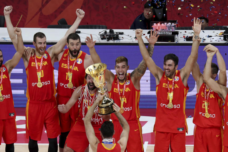 Spain's Marc Gasol, third from left cheer with teammates during the award ceremony for the FIBA Basketball World Cup Final, at the Cadillac Arena in Beijing, Sunday, Sept. 15, 2019. Spain has captured its second World Cup championship, defeating Argentina 95-75 on Sunday to give Marc Gasol a rare double-title year. (AP Photo/Ng Han Guan)
