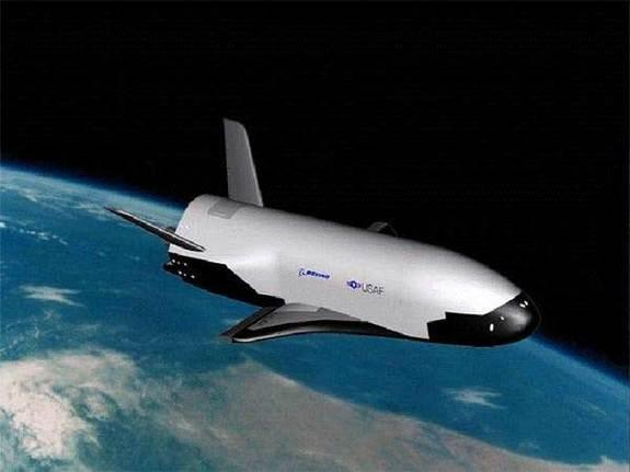 Now being readied for an orbital shakeout, the X-37B (shown here in an illustration) is an unpiloted military space plane. Launched from Florida, the vehicle will make an auto-touchdown in California. Credit: USAF