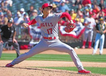 Apr 1, 2018; Oakland, CA, USA; Los Angeles Angels starting pitcher Shohei Ohtani (17) pitches the ball against the Oakland Athletics during the sixth inning at Oakland Coliseum. Kelley L Cox-USA TODAY Sports