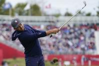 Team USA's Xander Schauffele hits a shot on the first hole during a practice day at the Ryder Cup at the Whistling Straits Golf Course Tuesday, Sept. 21, 2021, in Sheboygan, Wis. (AP Photo/Charlie Neibergall)