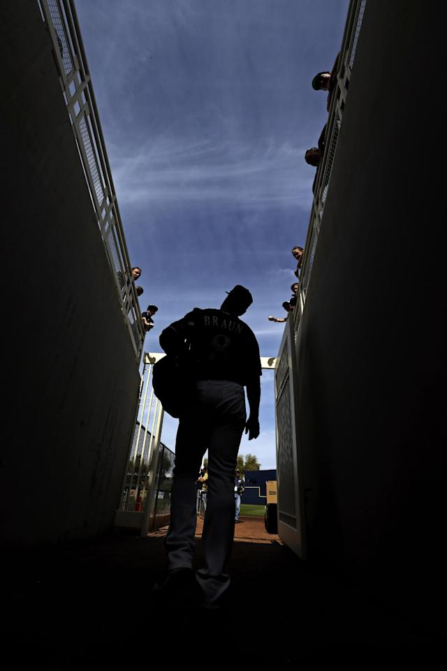 Milwaukee Brewers' Ryan Braun makes his way to an exhibition spring training baseball game against the Oakland Athletics Wednesday, March 5, 2014, in Phoenix. (AP Photo/Morry Gash)