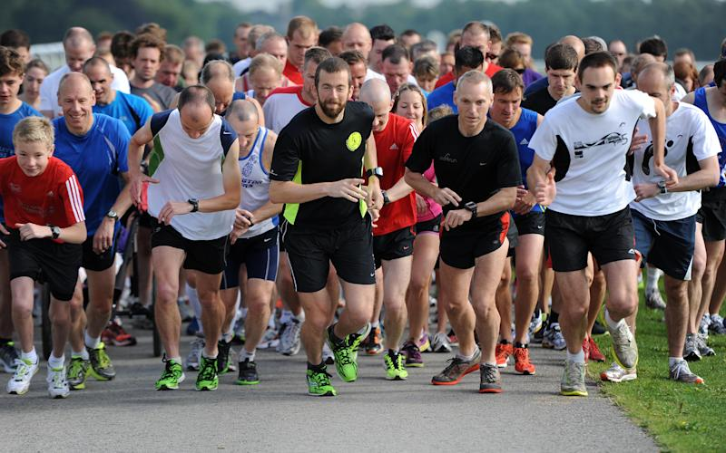 Runners set off at the start of the York Parkrun at the Knavesmire (York racecourse) - Asadour Guzelian