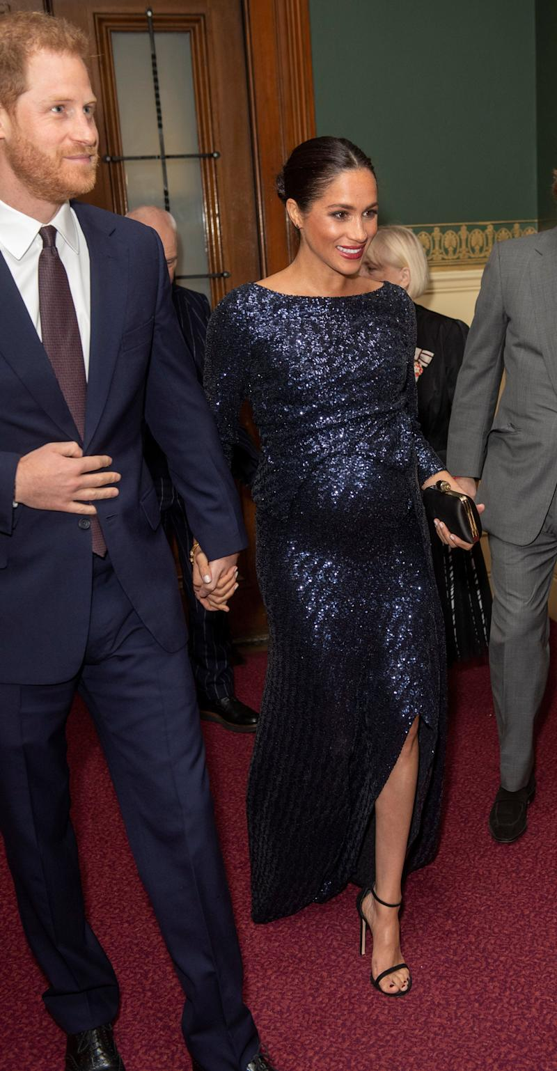 "Harry and Meghan attend the premiere of Cirque du Soleil's ""Totem"" at the Royal Albert Hall in London."