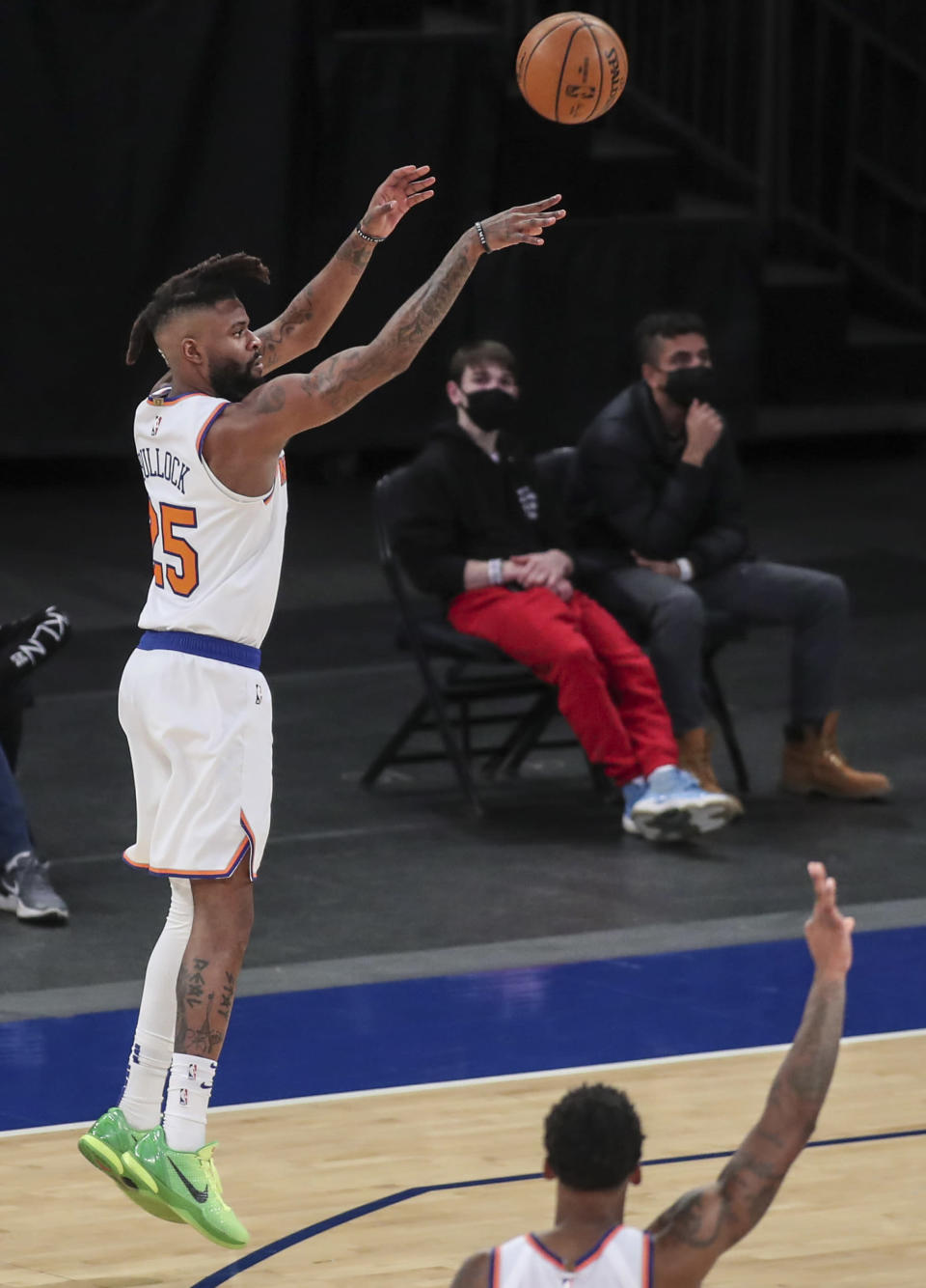 New York Knicks forward Reggie Bullock (25) takes a 3-point shot during the second quarter against the Detroit Pistons in an NBA basketball game Thursday, March 4, 2021, in New York. (Wendell Cruz/Pool Photo via AP)