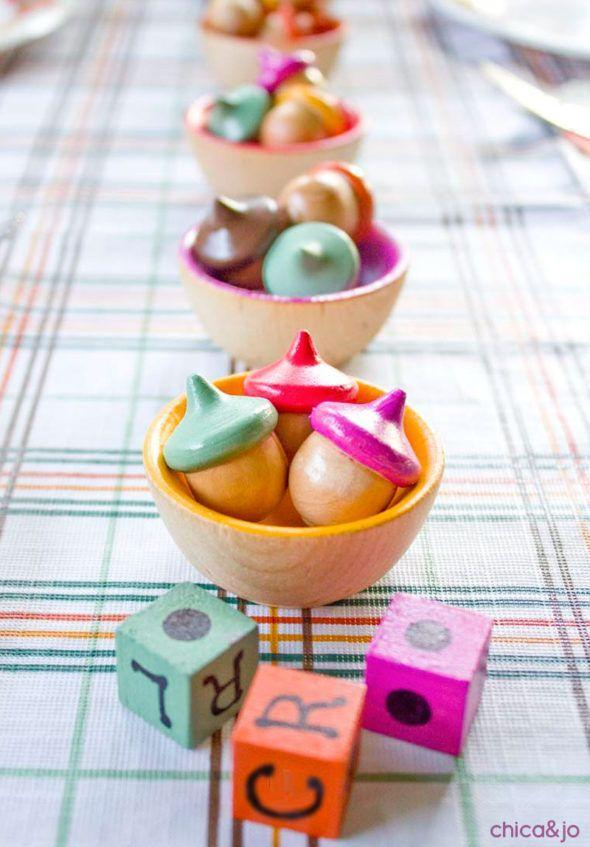 """<p>You can get the kids to help make the pieces for this game, a colorful take on the easy dice contest """"Left Center Right,"""" or just let them roll with it at the children's table.</p><p><strong>Get the tutorial at <a href=""""https://www.chicaandjo.com/thanksgiving-kids-table-game/"""" rel=""""nofollow noopener"""" target=""""_blank"""" data-ylk=""""slk:Chica and Jo"""" class=""""link rapid-noclick-resp"""">Chica and Jo</a>.</strong></p><p><a class=""""link rapid-noclick-resp"""" href=""""https://www.amazon.com/Wooden-Acorns-Counting-Sorting-Kit/dp/B076R5NKX4/ref=as_li_ss_tl?tag=syn-yahoo-20&ascsubtag=%5Bartid%7C10050.g.1201%5Bsrc%7Cyahoo-us"""" rel=""""nofollow noopener"""" target=""""_blank"""" data-ylk=""""slk:SHOP WOODEN ACORNS SET"""">SHOP WOODEN ACORNS SET</a><br></p>"""