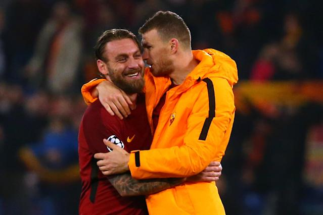 Soccer Football - Champions League Round of 16 Second Leg - AS Roma vs Shakhtar Donetsk - Stadio Olimpico, Rome, Italy - March 13, 2018 Roma's Daniele De Rossi celebrates with Edin Dzeko after the match REUTERS/Alessandro Bianchi