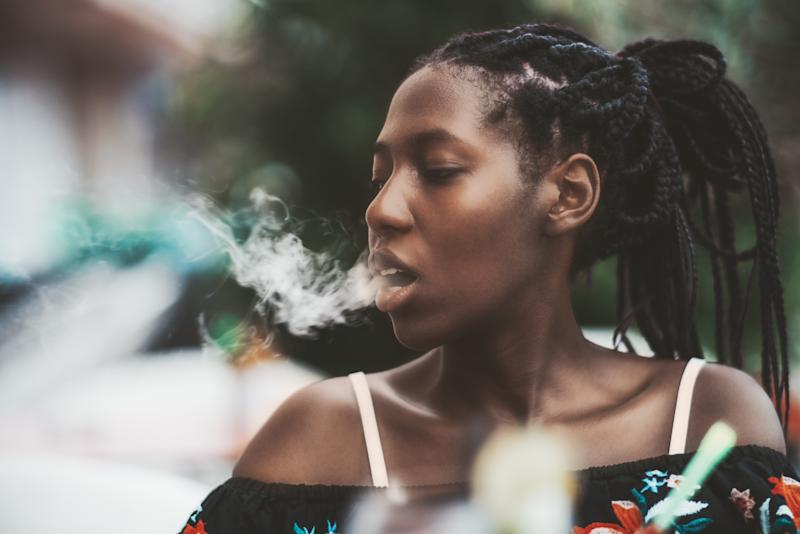 A new study from the Dana-Farber Cancer Institute has found that bisexual women of color have a higher prevalence of exposure to vaping ads than their white, heterosexual counterparts. (Photo: Getty Images)