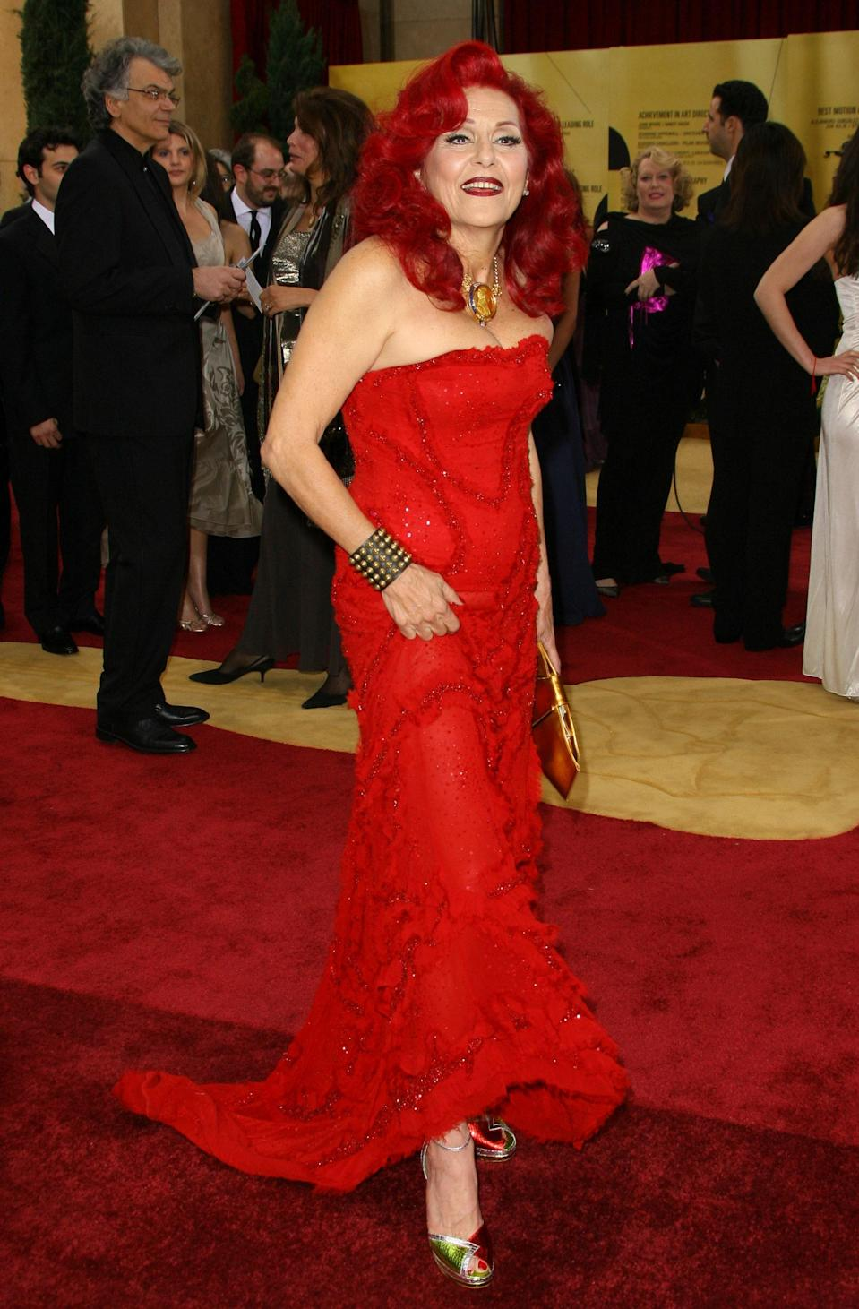 """Nominated for her iconic costume work in <em>The Devil Wears Prada</em>, Patricia Field—who also outfitted <em>Sex and The City</em>—had every high-fashion designer at her fingertips. Yet, she chose a look that spoke to her inimitable style. Her red gown was from fellow costume designer <a href=""""https://www.instagram.com/daviddalrympleinc/?hl=en"""" rel=""""nofollow noopener"""" target=""""_blank"""" data-ylk=""""slk:David Dalrymple"""" class=""""link rapid-noclick-resp"""">David Dalrymple</a>, who Field carried <a href=""""https://patriciafield.com/collections/david-dalrymple-for-house-of-field"""" rel=""""nofollow noopener"""" target=""""_blank"""" data-ylk=""""slk:in her store"""" class=""""link rapid-noclick-resp"""">in her store</a>. She accessorized with a vintage Bulgari necklace complete with diamonds, rubies, and sapphires and a pair of Payless shoes, mastering the art of high-low dressing on the red carpet."""