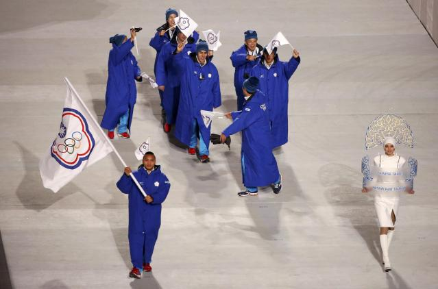 Taiwan's flag-bearer Sung Ching-Yang leads his country's contingent during the athletes' parade at the opening ceremony of the 2014 Sochi Winter Olympics, February 7, 2014. REUTERS/Lucy Nicholson (RUSSIA - Tags: OLYMPICS SPORT)