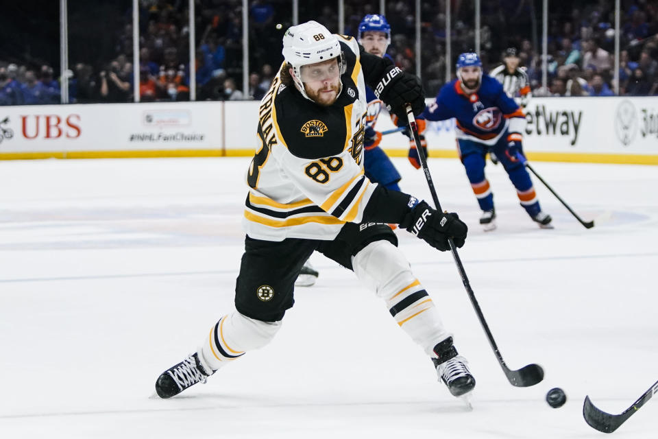 Boston Bruins' Kevan Miller (86) shoots the puck during the first period of Game 4 during an NHL hockey second-round playoff series against the New York Islanders, Saturday, June 5, 2021, in Uniondale, N.Y. (AP Photo/Frank Franklin II)