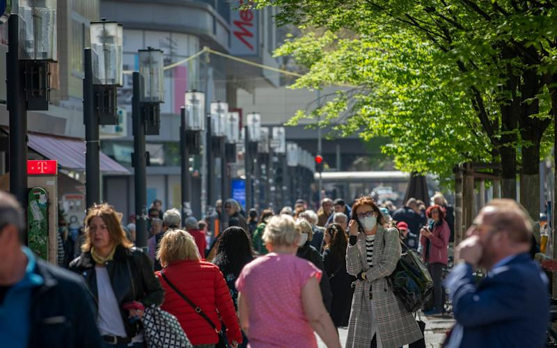 A full high Street as shoppers are out and about in Berlin as the German economy moves out of partial lockdown from the Corona Virus. Wlimersdorfer Strasse, Charlottenburg. - Craig Stennett for the Telegraph