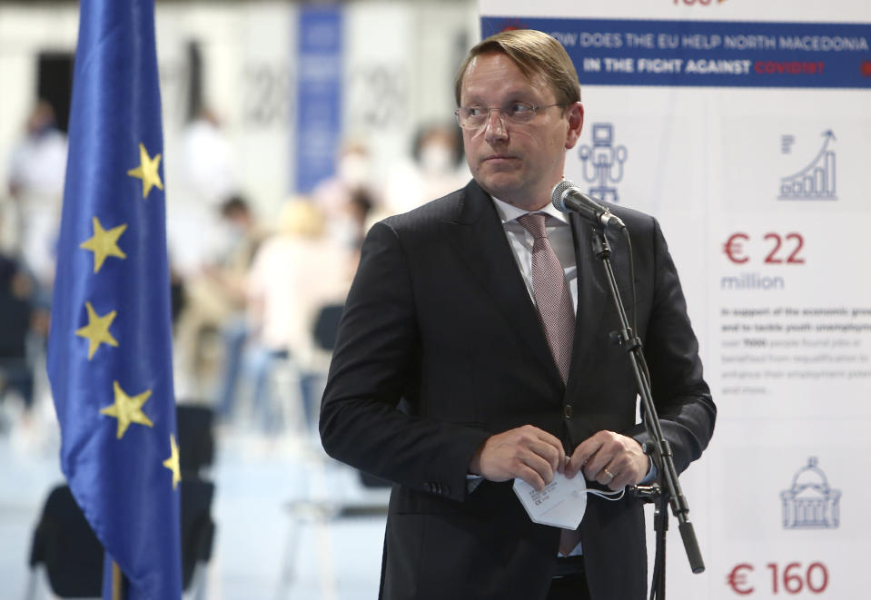 European Commissioner for Neighborhood and Enlargement Oliver Varhelyi talks to the media in the presence of Austrian Federal Minister for EU Karoline Edstadler and North Macedonia's Prime Minister Zoran Zaev, after visiting the center for mass vaccination against COVID-19, at A1 Arena in Skopje, North Macedonia, on Tuesday, May 4, 2021. The European Union started delivering EU-funded coronavirus vaccines Tuesday to the Balkans, a region that wants to join the 27-nation bloc but where China and Russia have already been supplying the much-needed shots and making political gains. (AP Photo/Boris Grdanoski)