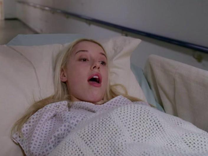 Katie Bryce on Greys Anatomy in a hospital bed mostly covered with blanket