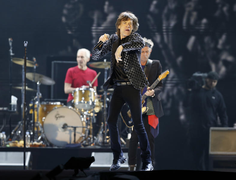 "FILE - This Feb. 26, 2014 file photo shows Mick Jagger and the Rolling Stones performing during their concert at Tokyo Dome in Tokyo. The Rolling Stones have called off their tour dates in Australia and New Zealand following the death of Mick Jagger's girlfriend and designer L'Wren Scott on Monday, March 17, 2014. The iconic band says in a statement Tuesday they ""are deeply sorry and disappointed to announce the postponement of the rest of their 14 ON FIRE tour."" (AP Photo/Shizuo Kambayashi, File)"