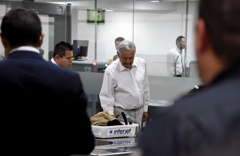 Andres Manuel Lopez Obrador gained popularity during his election campaign by promising to reduce his salary and those of top government officials (AFP Photo/Alfredo ESTRELLA)