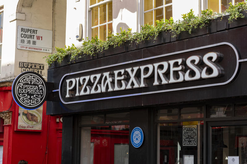 Pizza Express logo and sign at their restaurant in China...