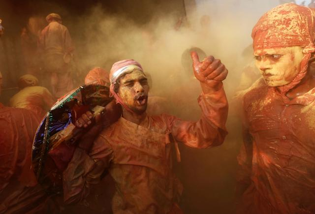 <p>Hindu devotees take part in the religious festival of Holi inside a temple in Nandgaon village, in the state of Uttar Pradesh, India Feb. 25, 2018. (Photo: Adnan Abidi/Reuters) </p>