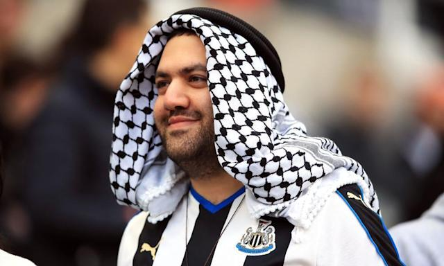 """<span class=""""element-image__caption"""">A Newcastle fan responds to rumours of a Saudi takeover.</span> <span class=""""element-image__credit"""">Photograph: Owen Humphreys/PA</span>"""