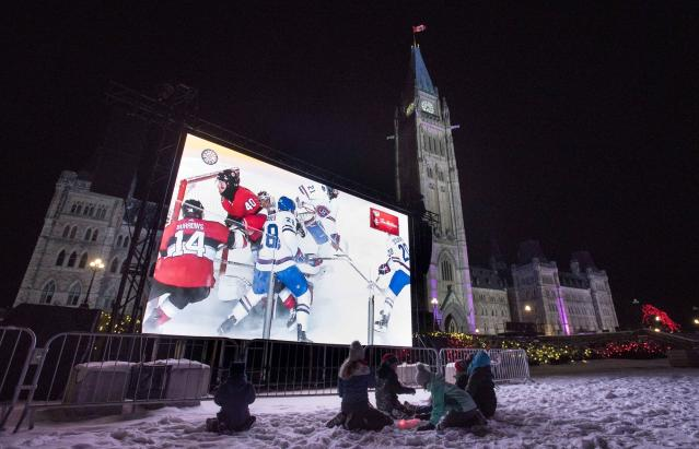 <p>A giant video screen on Parliament Hill's west lawn streams the NHL 100 Classic at nearby Landsdowne Park in Ottawa on Saturday. </p>