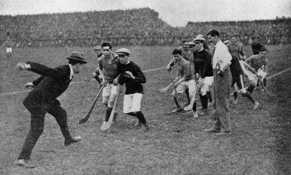 Michael Collins throwing in the ball to start a hurling match at Croke Park in 1921.