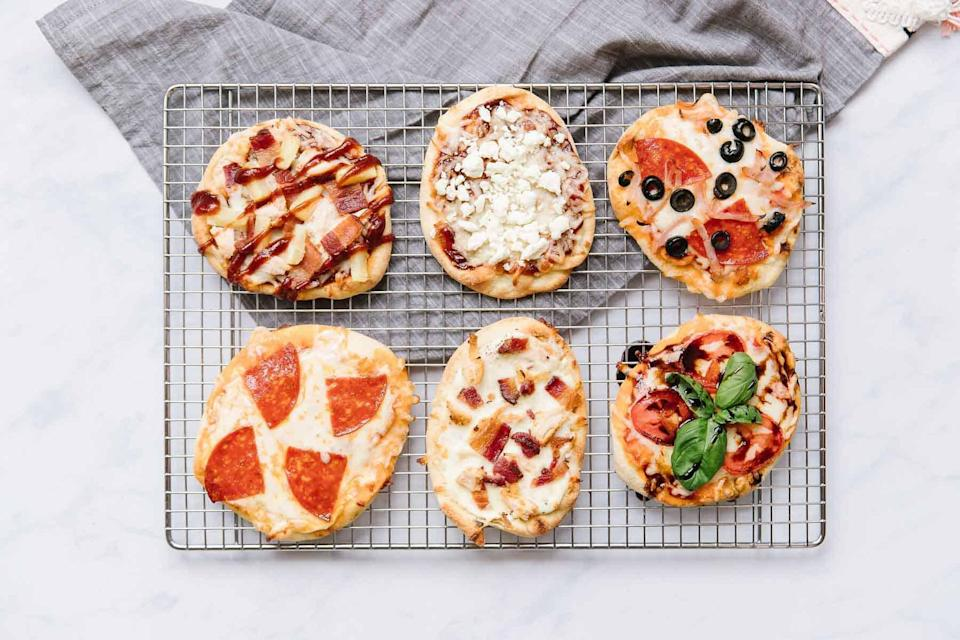 """<p>Perfect for <a href=""""https://www.thedailymeal.com/recipes-weeknight-dinners-simple?referrer=yahoo&category=beauty_food&include_utm=1&utm_medium=referral&utm_source=yahoo&utm_campaign=feed"""" rel=""""nofollow noopener"""" target=""""_blank"""" data-ylk=""""slk:a simple weeknight dinner"""" class=""""link rapid-noclick-resp"""">a simple weeknight dinner</a>, these mini naan pizzas will be fun for the whole family to make on Father's Day too.</p> <p><a href=""""https://www.thedailymeal.com/recipes/mini-naan-pizzas-recipe?referrer=yahoo&category=beauty_food&include_utm=1&utm_medium=referral&utm_source=yahoo&utm_campaign=feed"""" rel=""""nofollow noopener"""" target=""""_blank"""" data-ylk=""""slk:For the Mini Naan Pizzas recipe, click here."""" class=""""link rapid-noclick-resp"""">For the Mini Naan Pizzas recipe, click here.</a></p>"""