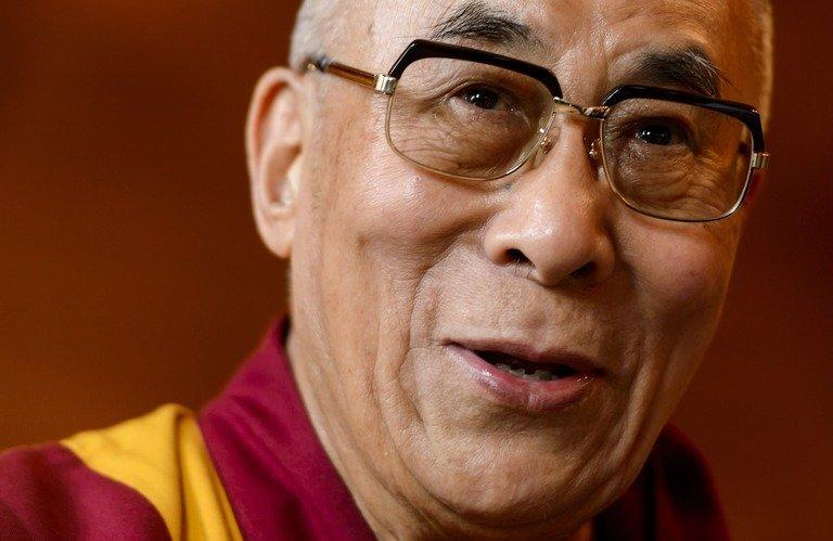 The Dalai Lama gives a press conference after visiting the Swiss House of Parliament on April 16, 2013 in Bern. Democracy champion Aung San Suu Kyi and the Dalai Lama will attend a human rights forum in Prague next month, its spokesman said