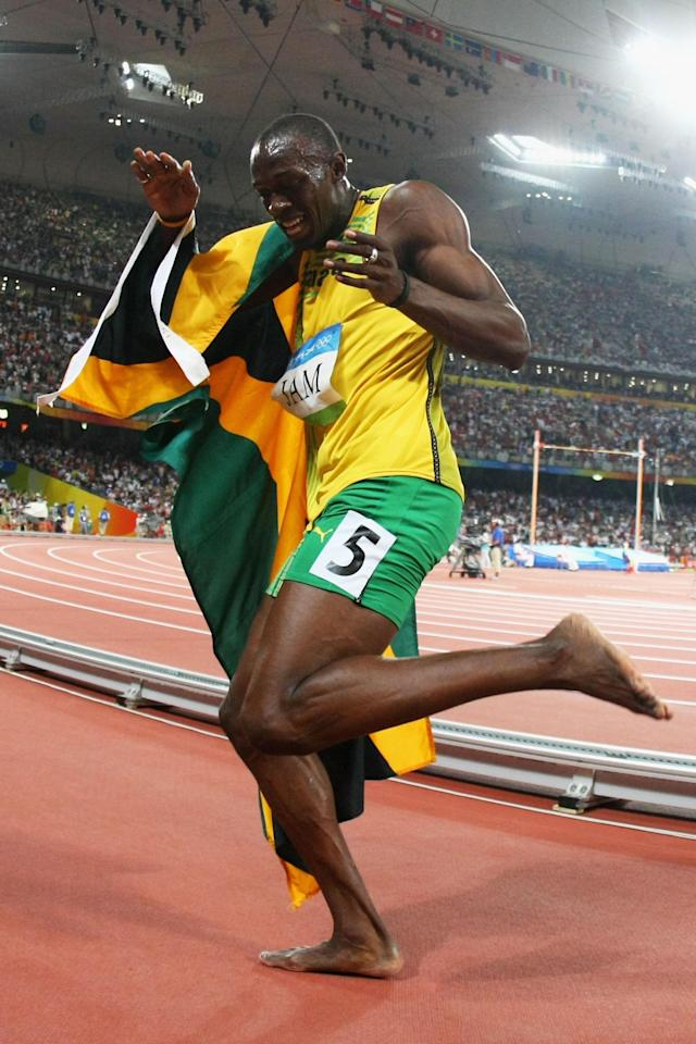BEIJING - AUGUST 22: Usain Bolt of Jamaica celebrates after running the third leg in the Men's 4 x 100m Relay Final at the National Stadium on Day 14 of the Beijing 2008 Olympic Games on August 22, 2008 in Beijing, China. (Photo by Alexander Hassenstein/Bongarts/Getty Images)