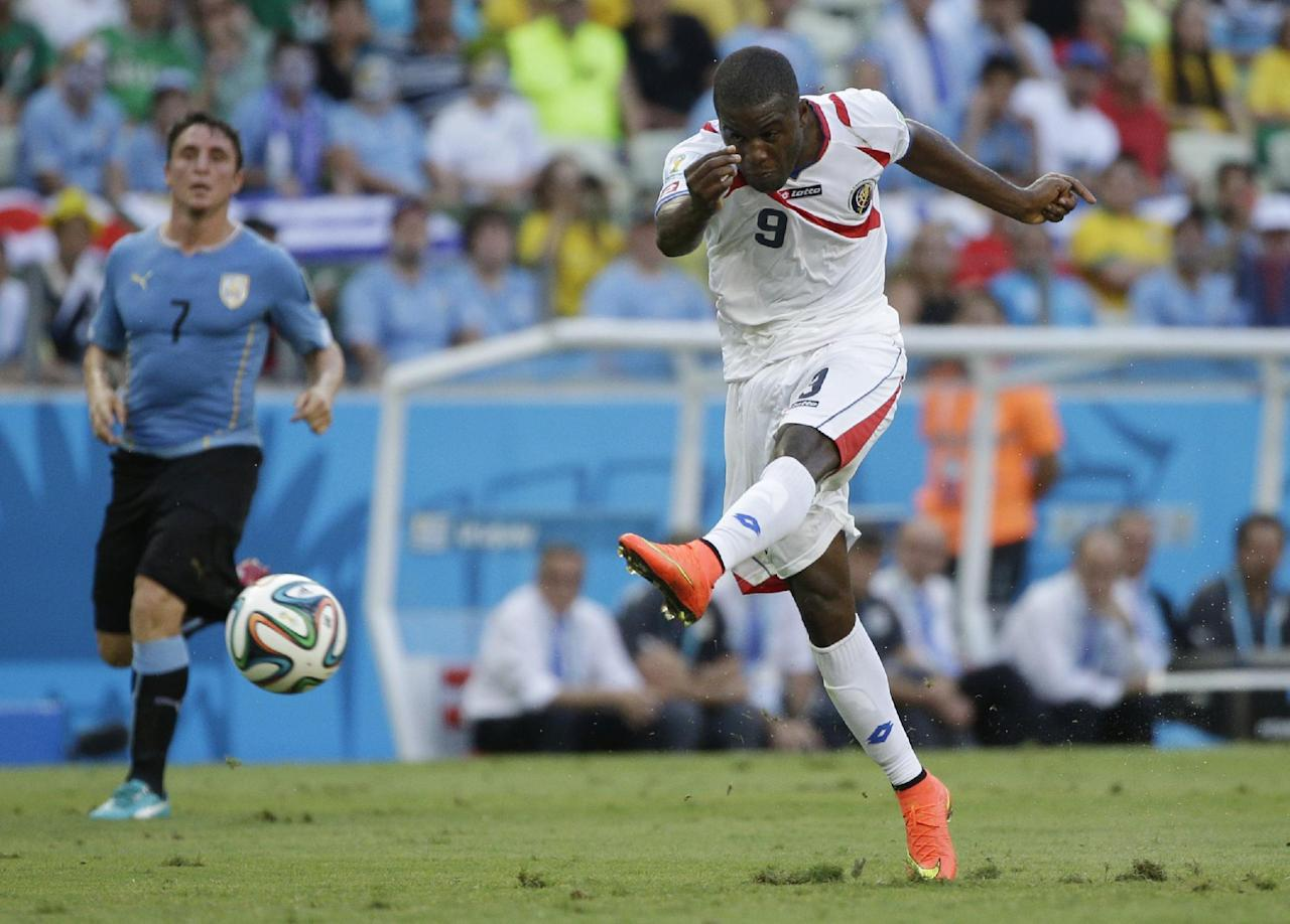 Costa Rica's Joel Campbell has a shot on goal during the group D World Cup soccer match between Uruguay and Costa Rica at the Arena Castelao in Fortaleza, Brazil, Saturday, June 14, 2014.(AP Photo/Christophe Ena)
