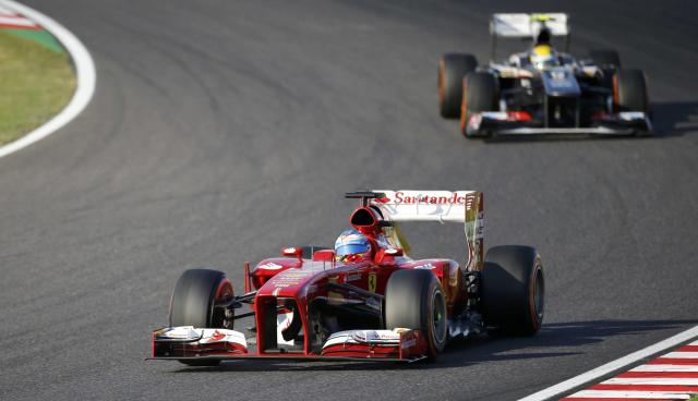 Ferrari Formula One driver Fernando Alonso of Spain races during the Japanese F1 Grand Prix at the Suzuka circuit October 13, 2013. REUTERS/Issei Kato (JAPAN - Tags: SPORT MOTORSPORT F1)