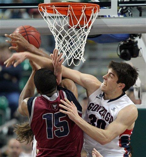 Loyola Marymount's Alex Osborne and Gonzaga's Mike Hart reach for a rebound during the first half of a West Coast Conference tournament NCAA college basketball game Saturday, March 9, 2013, in Las Vegas. (AP Photo/Isaac Brekken)